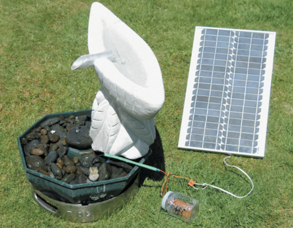 Solar-powered water feature. Note the half-submerged windscreen washer pump.