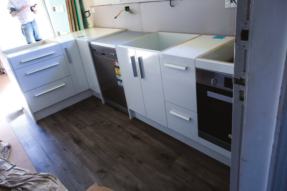 Our completed, installed flat-pack kitchen, just waiting for the bench top to finish off the job
