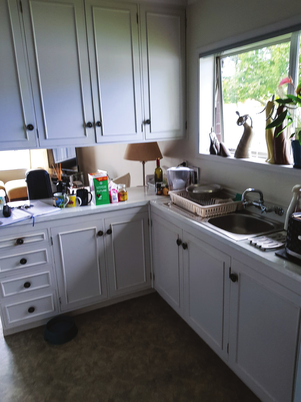 The old existing kitchen was dated and darkened by the ceiling-hung units