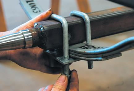 Locate axle and bolt onto springs.
