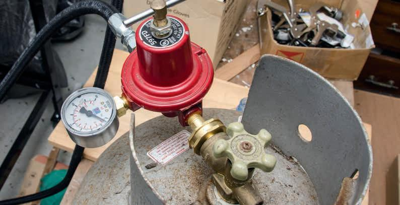 The pressure valve with gauge.