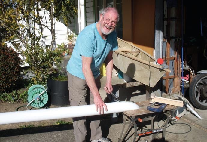 Stuart works on stainless rod for outrigger hook in the ama
