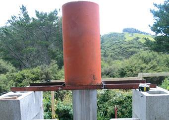 Welded angle-iron frame supports field tile around flue.