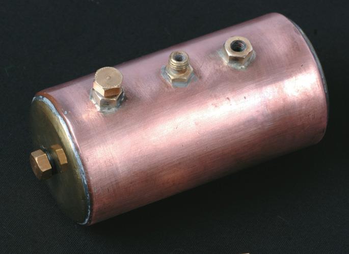 From left, boiler holes for level check (in end), filling, steam outlet, safety valve.