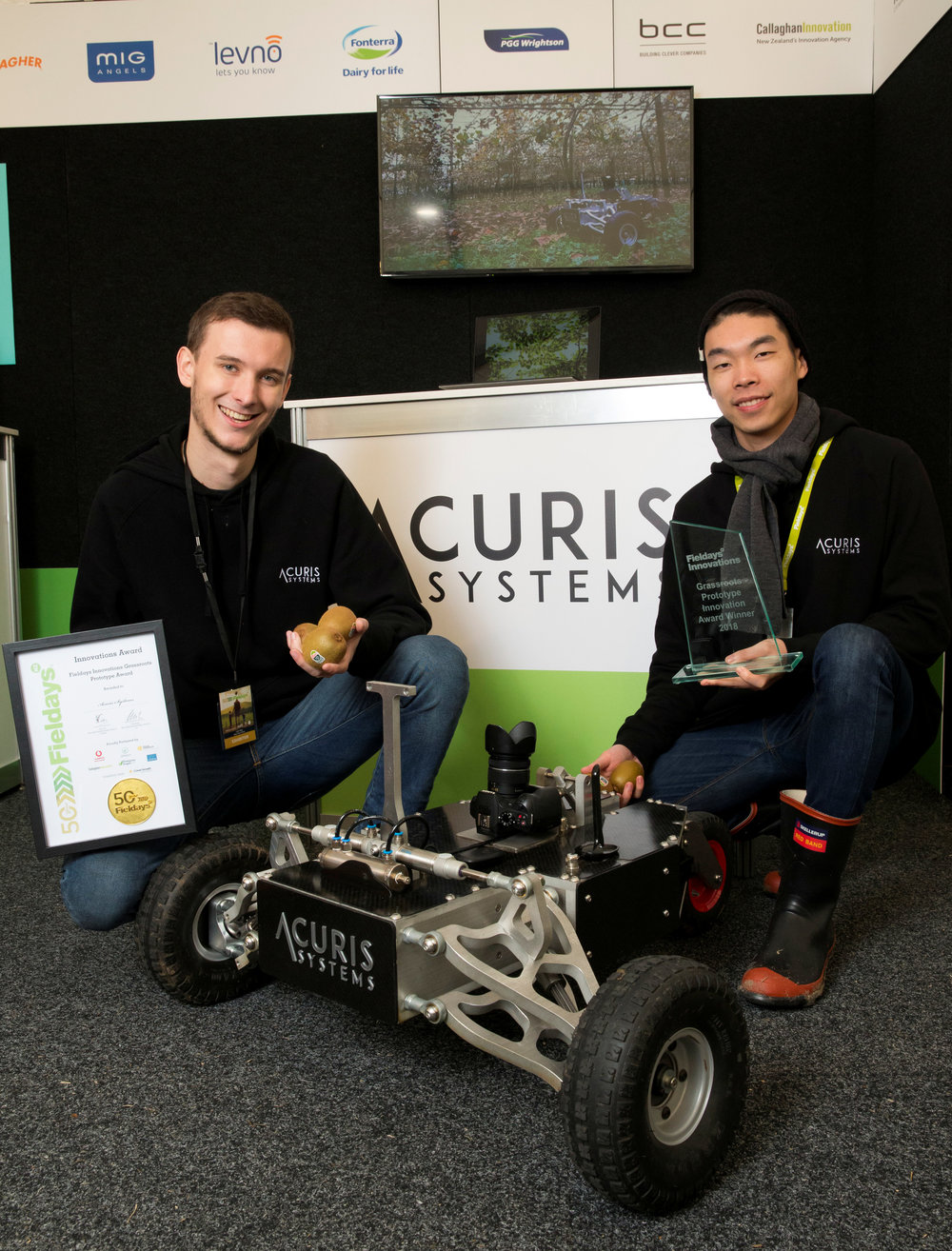 2018 Fieldays Grassroots Prototype Award winners Acuris Systems with their prototype robot that autonomously navigates kiwifruit orchards while capturing highly accurate fruit data. This data is then analysed to provide growers with quality information and insights to their orchards performance