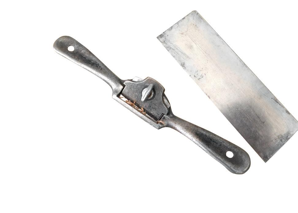 Neil's two essential hand tools - a spokeshave and a scraper.