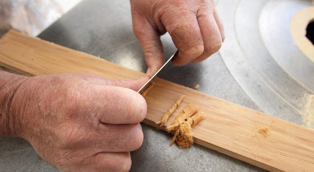 Using the scraper – better than sandpaper.
