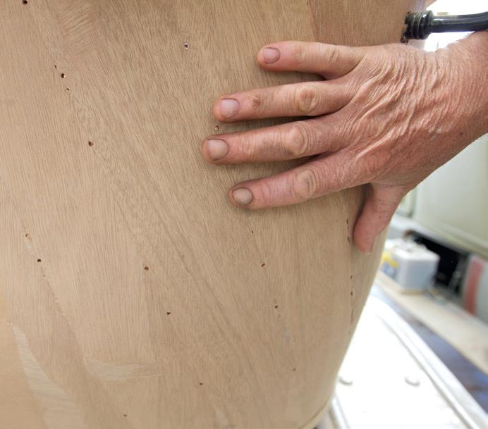 Where the body curves, the ply has been fitted in strips that are twisted on an angle to stop the edges protruding.