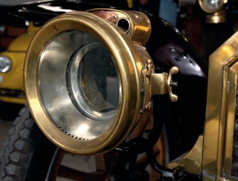 ..the brass Lucas acetylene lamps. The tank was mounted on one of the running boards.