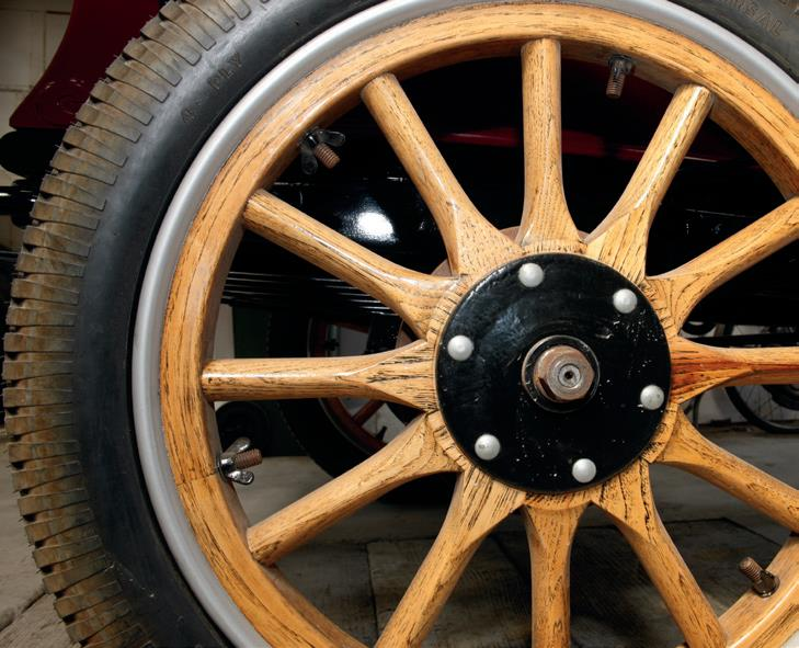The oak wheels that have been made from scratch by Vern Jensen of Fielding. The wing nuts are unscrewed and lead washers added to balance the wheels. This system was also used on such cars as Bentley and Rolls Royce up to World War II. Roy King will be machining brass hubcaps to fit onto the wheels.