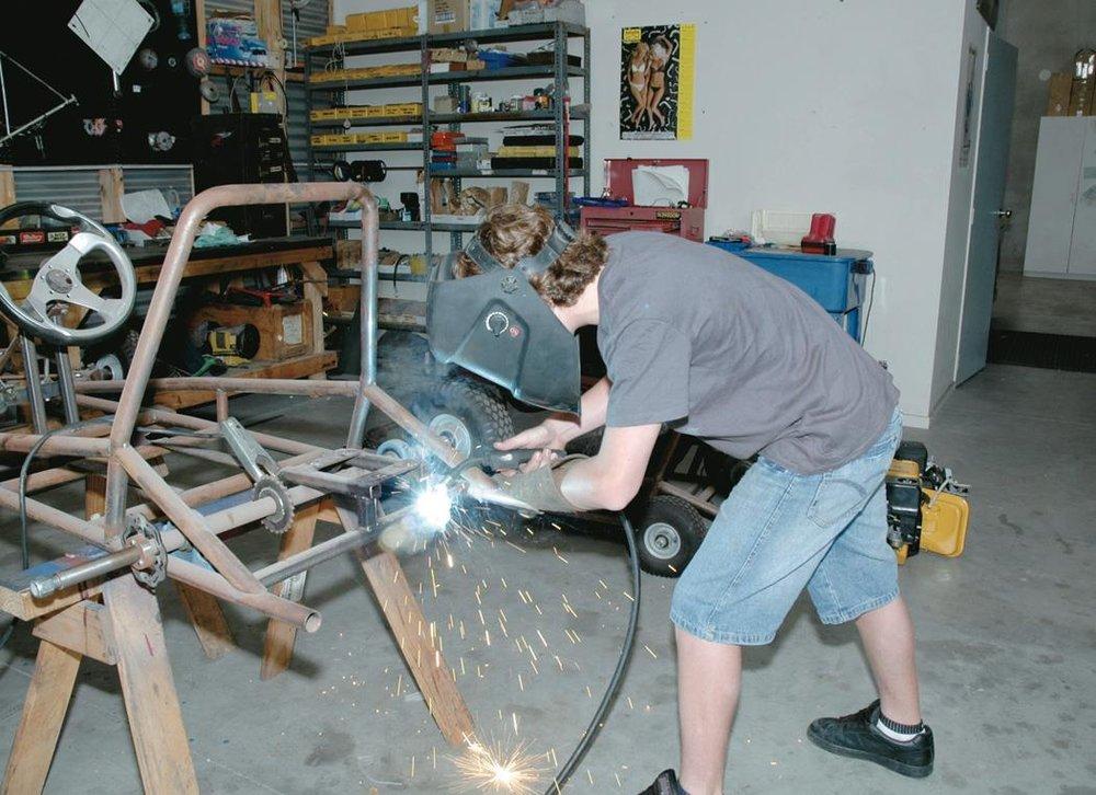 Kurt welds the engine supports