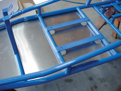 Base pan in place. Note the access holes for the seat bolts.