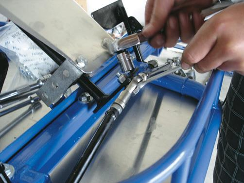Attaching the steering arms.