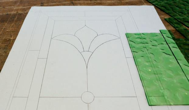 The design used to cut the glass pieces and assemble the panel.