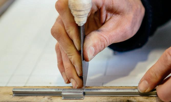 Using a piece of lead as a marker to cut equal lengths.
