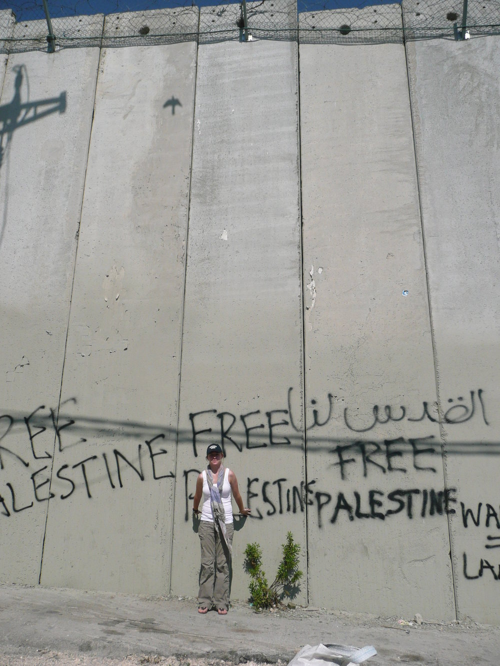 "The author in front of the Israeli ""separation barrier."" July 2011"