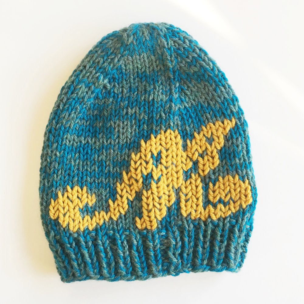 baby hat in custom two-tone teal colorway with embroidered 'm' monogram