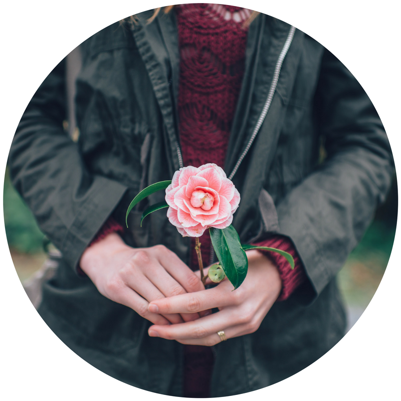 woman holding flower.png