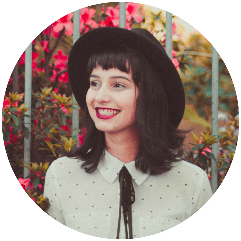 woman hat smiling looking left.png