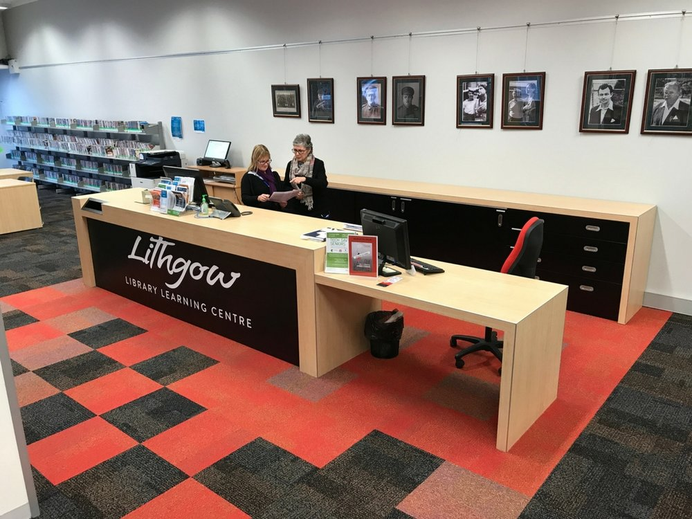 After - at five metres long and three metres deep, the new desk is highlighted with coloured carpet tiles to draw focus and attention to the area