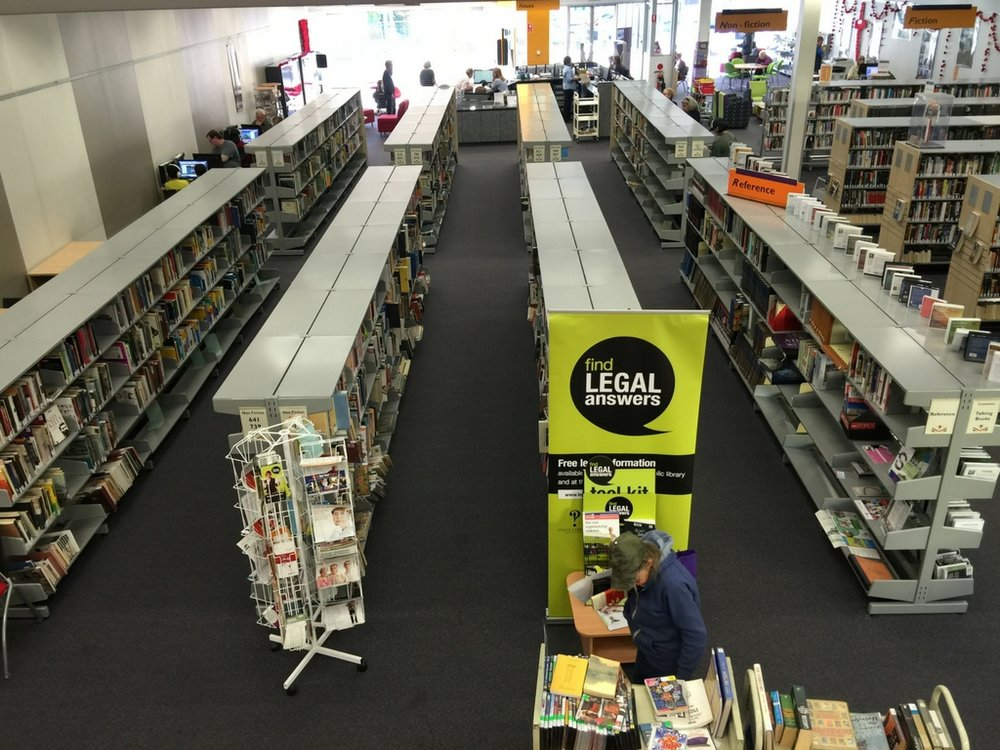 Before - long straight aisles of shelving units were bulky and in need of a revamp