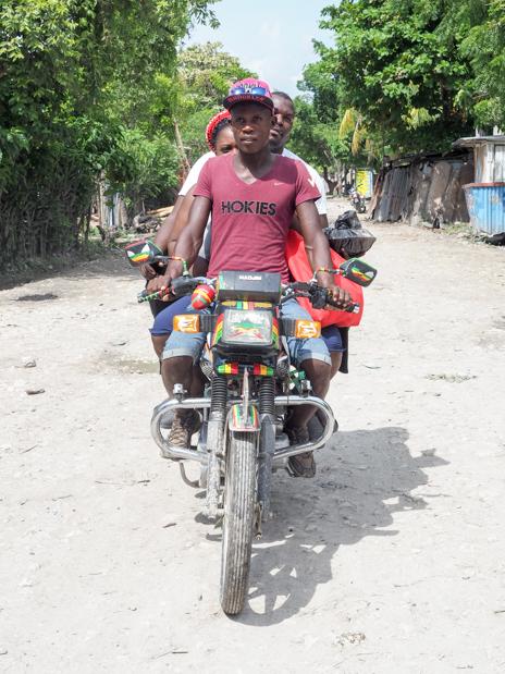 Three people on a motorbike