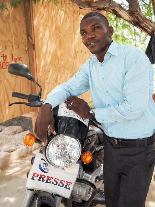 Pastor Fednel and his motorbike