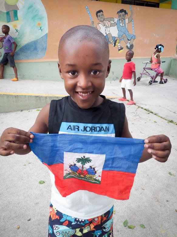 Boy with a Haitian flag, Hope House Orphanage