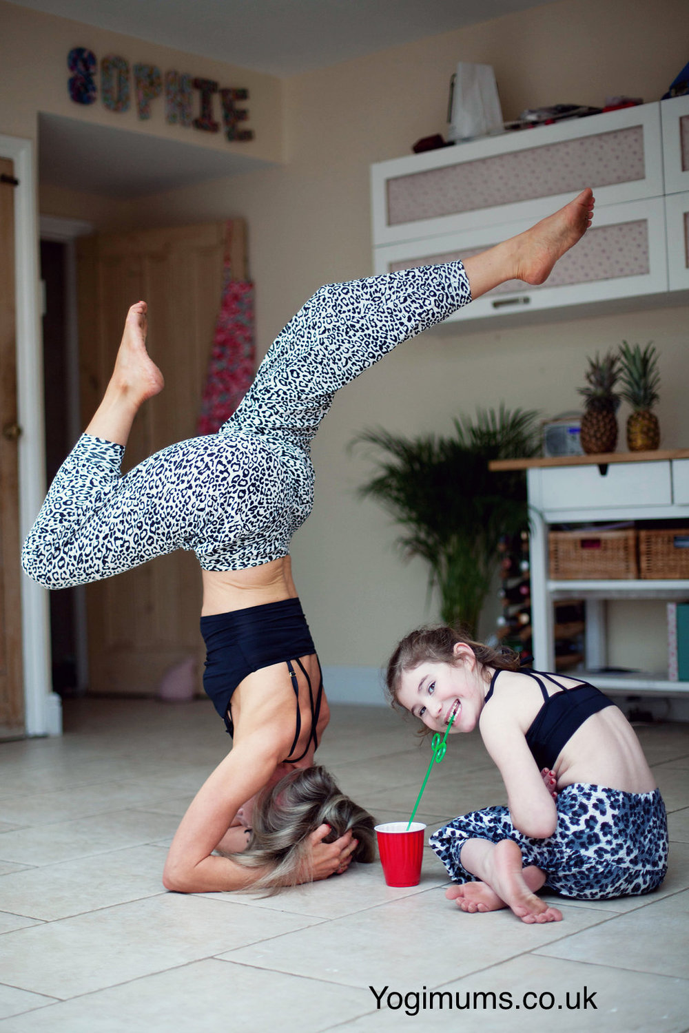 yoga with children. yoga in kitchen. yoga fun with kids. headstand. online yoga. playful yoga. yoga in Bristol. Yogimums