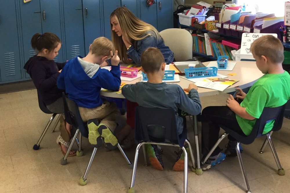 First Grade Teacher Jessica Smith with students at Putnam Elementary School.