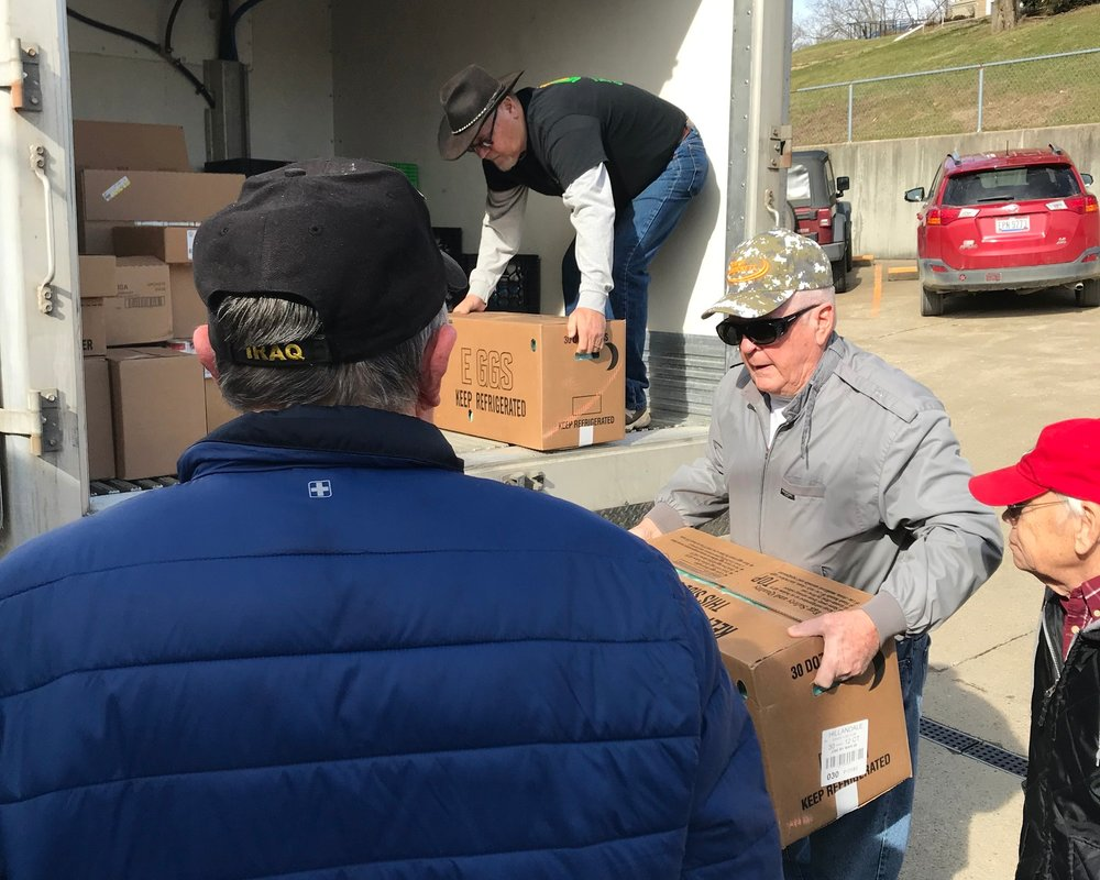 Several volunteers from Harvest of Hope and Tri-County Food Pantry unload over 700 lbs of donated food.