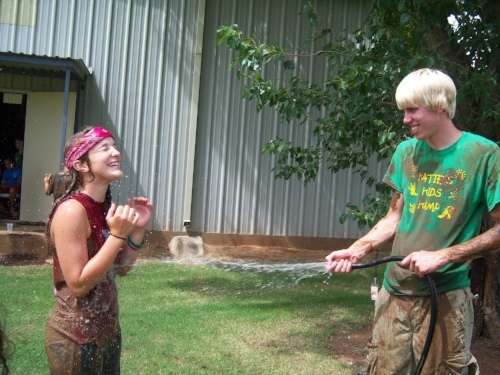 Aaron rinsing off Erin after the mud pit in 2008.