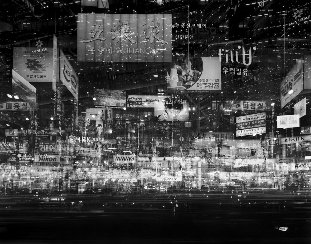 Simon Wan, Seoul – Namdaemunno II, Seoul, 2008 Multiple exposures of photographs of Seoul, Hong Kong and Beijing reflect the development of these cities, as well as the dangers associated with this, including pollution and inequality.