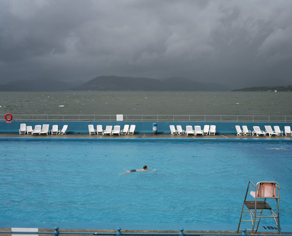 Gourock Lido, Scotland, United Kingdom, 2004. From A8. - Top Photo: Szechenyi thermal baths, Budapest, Hungary, 1997. Copyright: © Martin Parr, Magnum Photos, Rocket Gallery