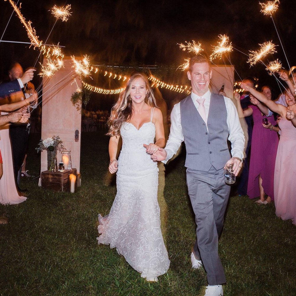 Bride and groom exiting with sparklers at the Judd and Mary Grace Kennedy Wedding.