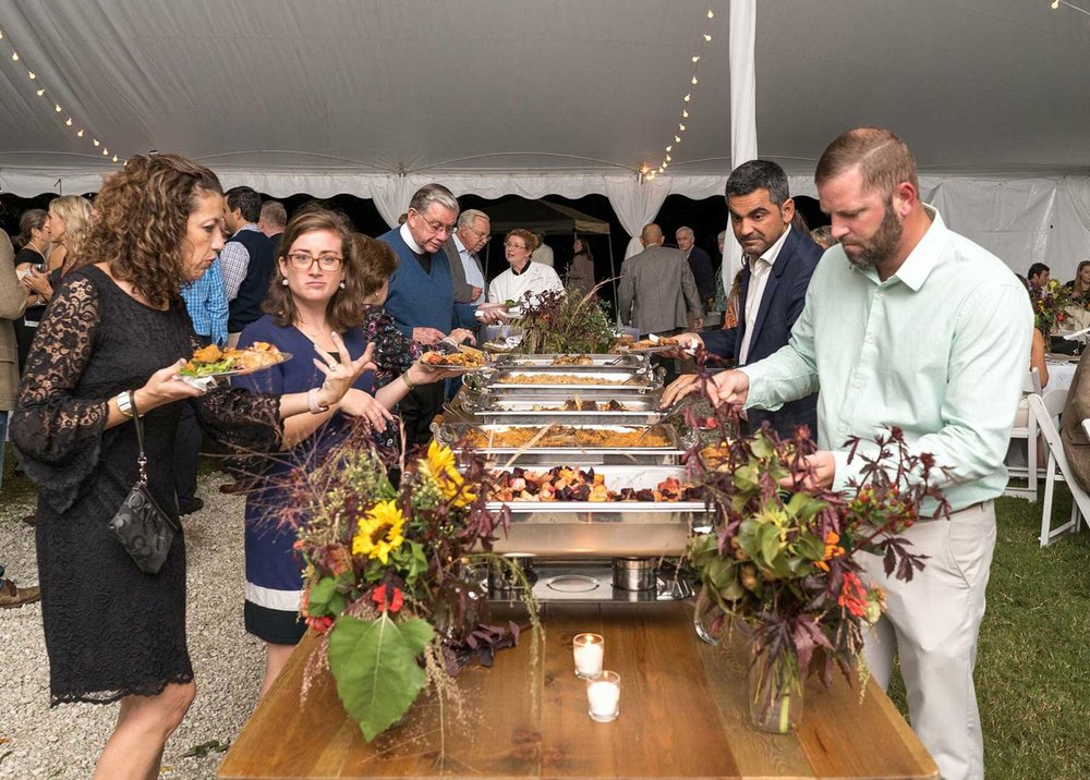 Guests at the buffet at the Pearls to Pluff Mud Event at Swamp Fox Farms in Hardeeville, SC.