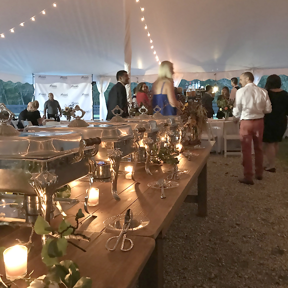 Guest under the tent at the Pearls to Pluff Mud Event at Swamp Fox Farms in Hardeeville, SC.