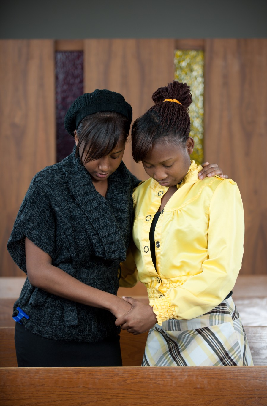 Jordina and Esther praying in chapel.jpg