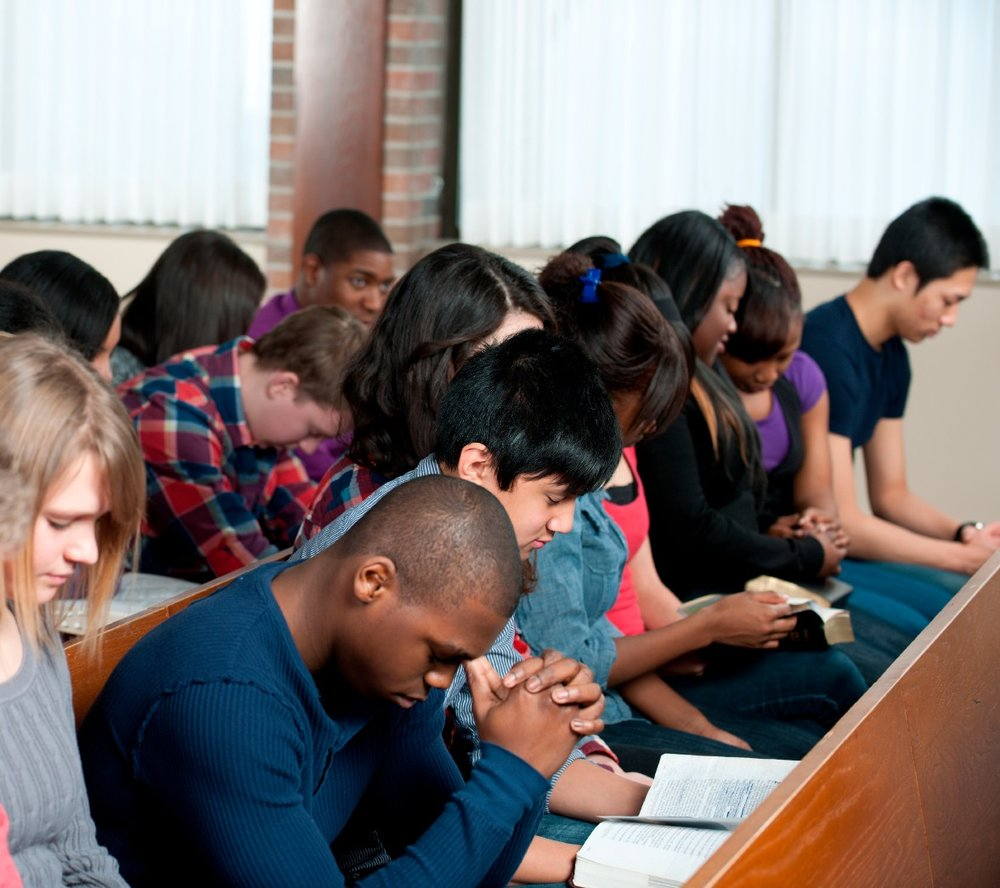 Students praying in chapel.jpg