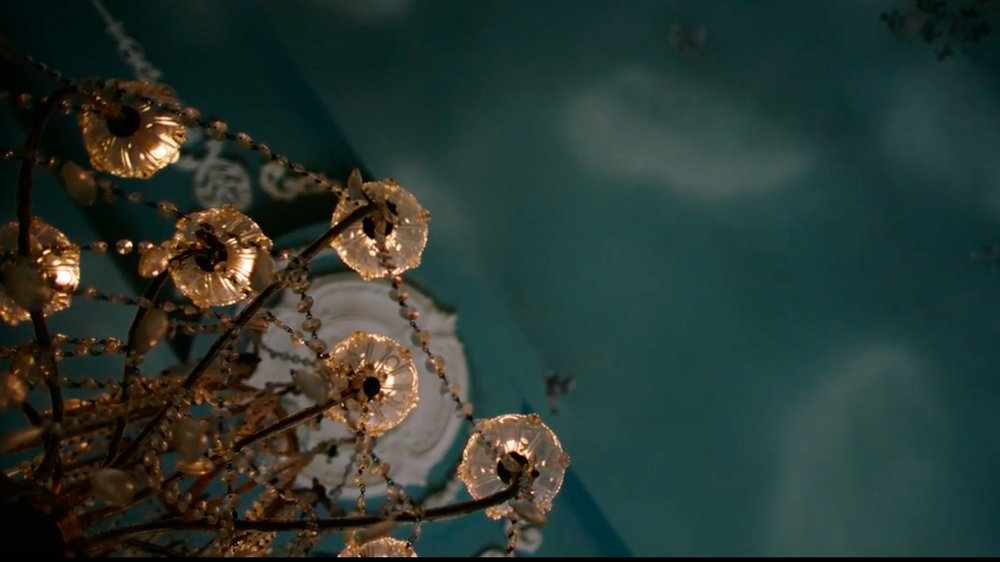 Teal ceiling with chandelier Handmaids Tale