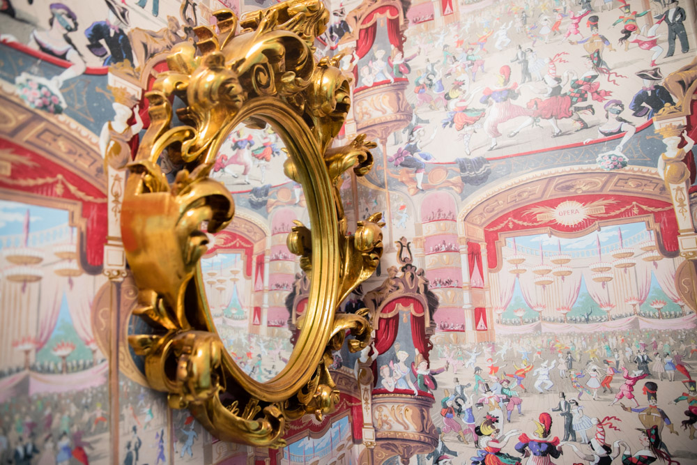 Whimsical cabaret wallpaper Cole and Son in a small powder room