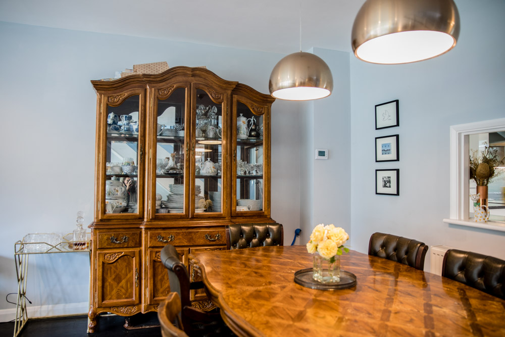Antique furniture in dining area with grey walls