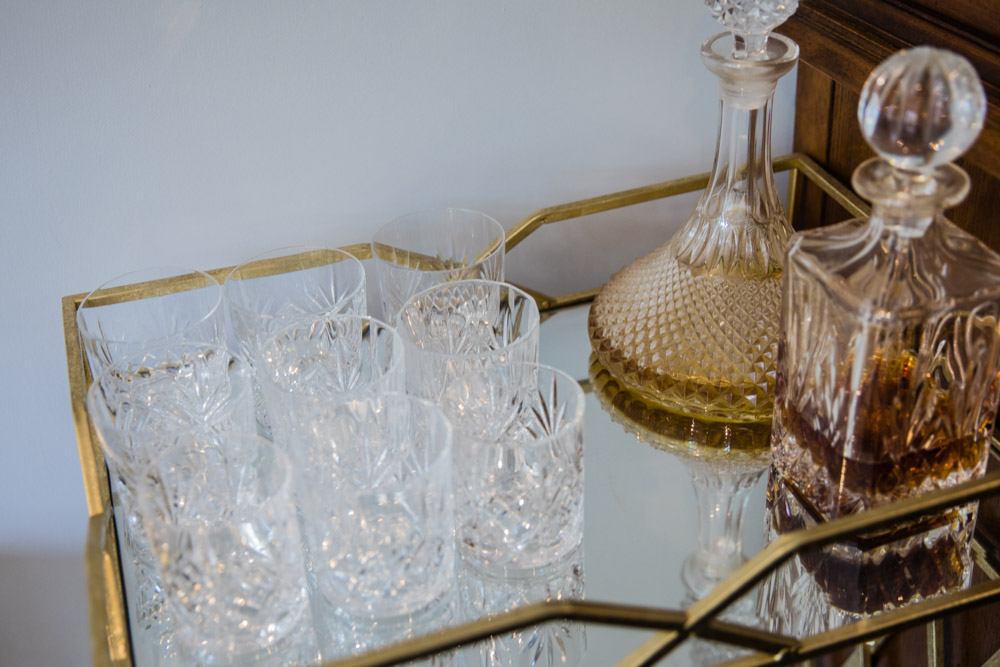 Cut glass drinks area on gold mirror table