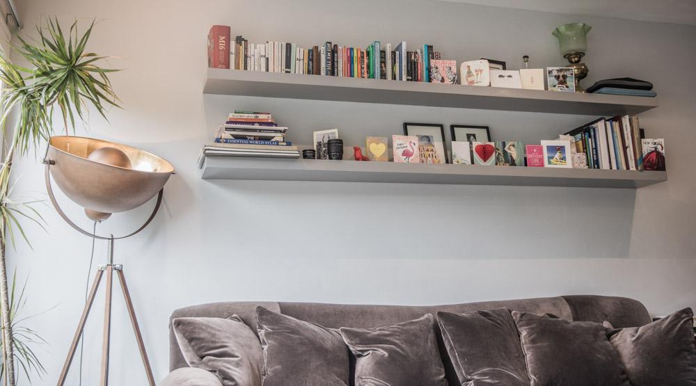 Soft grey walls and velvet sofa