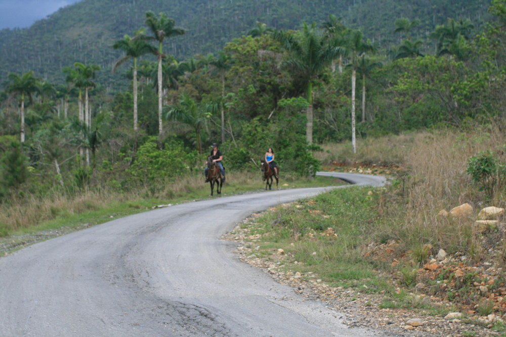 John and I riding through the jungle (on our own!)