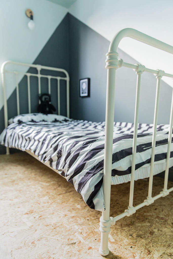 White cast iron bed monochrome kids room