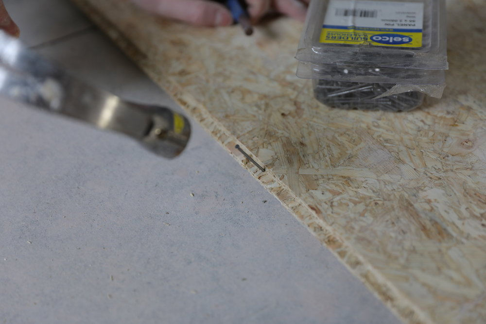 Inserting a nail in the groove of the boards to really help them stay in place