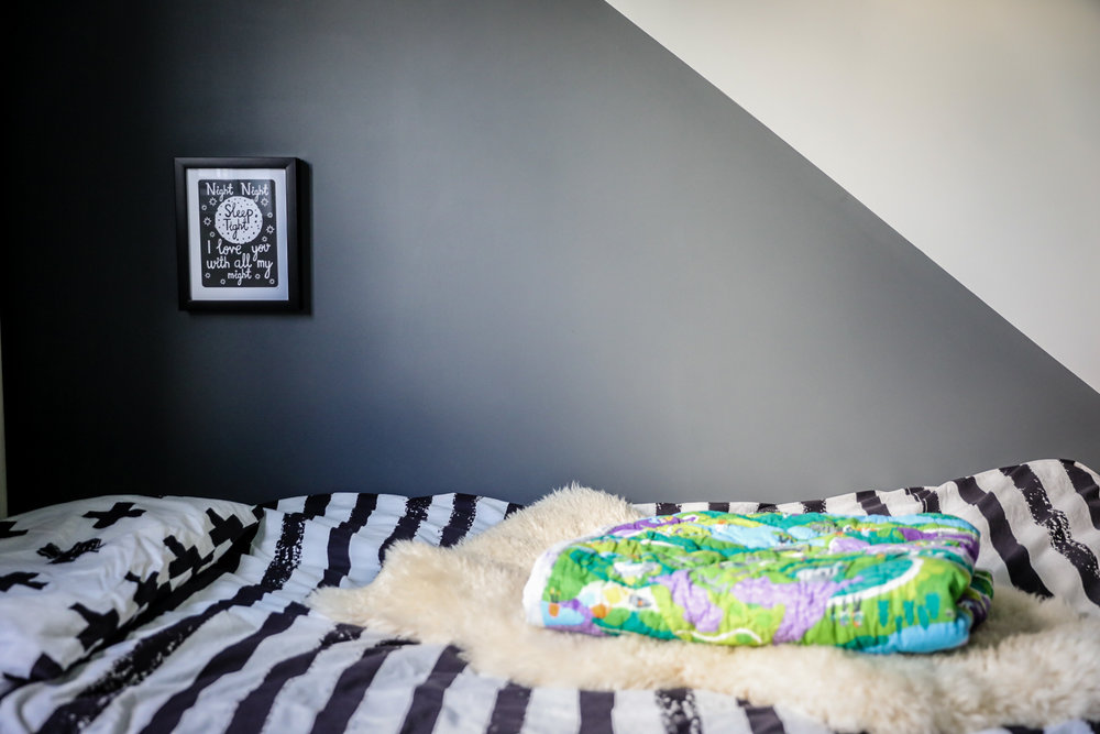 Monochrome kids bedroom with sheepskin and Snuggle Truffle quilt