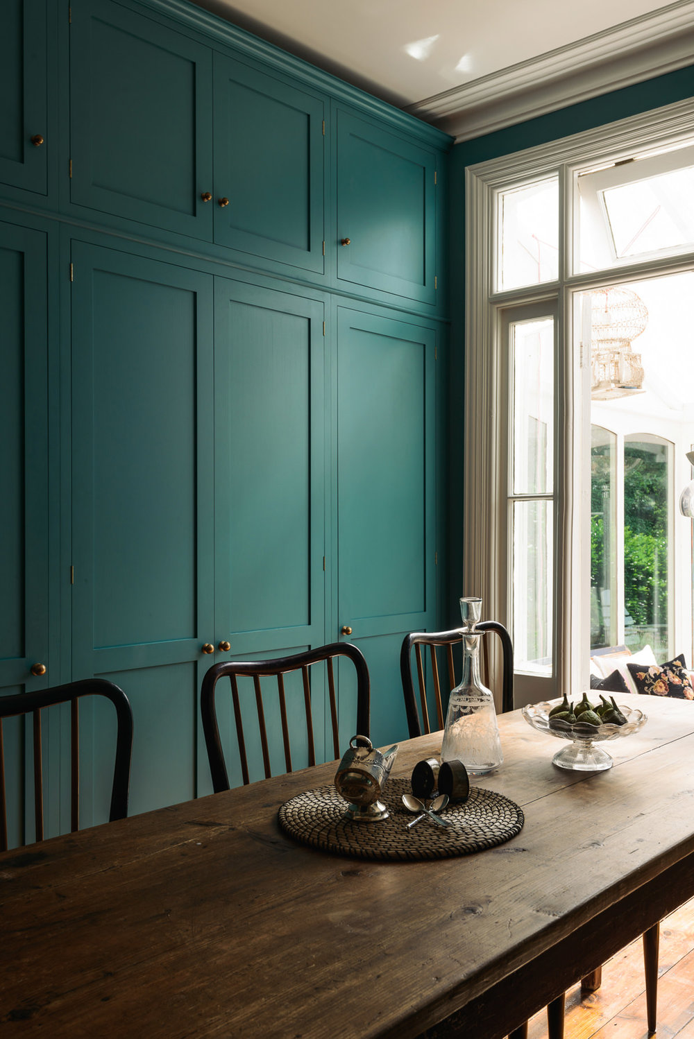 I love how the colour here (it must be Vardo by Farrow and Ball?) adds a little playfulness but how the space still retains an elegant feel. Image credit:  DeVOL Kitchens