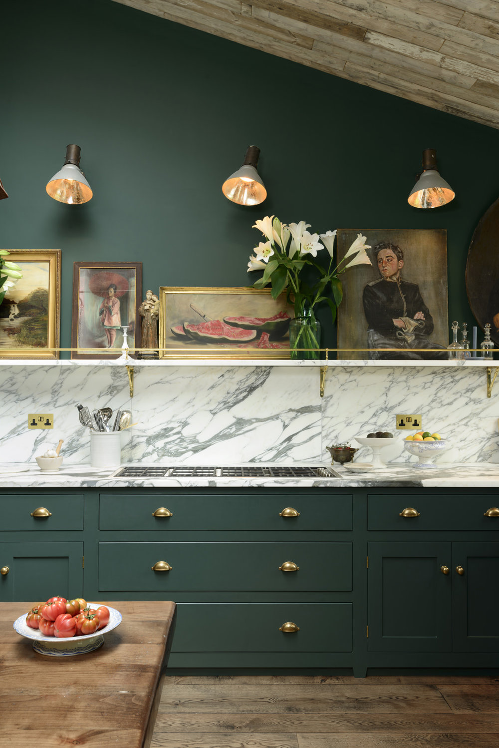 Style and elegance abounds here with the dark green, brass detailing and stunning marble. This is just a dream! Image credit:  DeVOL Kitchens